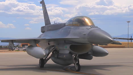 F15-And-F16-Fighter-Jets-Line-Up-And-Taxi-For-Takeoff