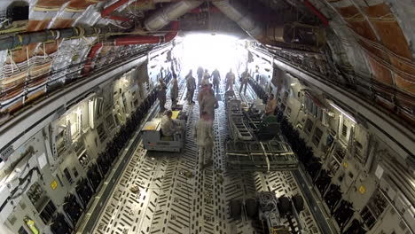 Time-Lapse-Of-Activities-In-The-Cargo-Bay-Of-A-Military-Cargo-Plane