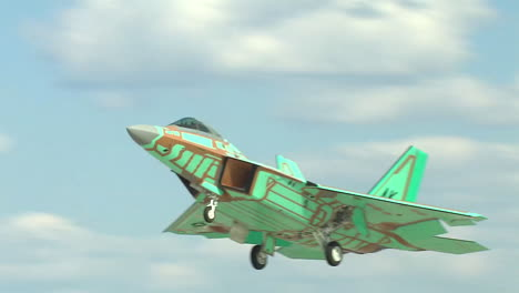 Green-Camouflaged-F15-Jet-Aircraft-Taking-Off-From-A-Military-Base