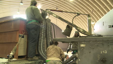 Bullets-Are-Fed-Into-Machine-Guns-Mounted-Onto-A10-Air-Force-Fighter-Jets-In-Preparation-For-Battle