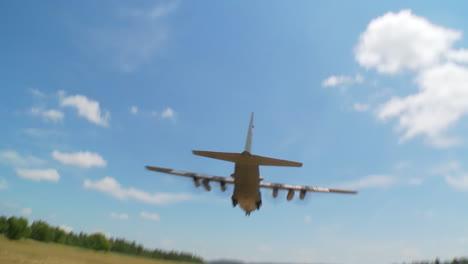 A-C130-Cargo-Plane-Lands-On-A-Dirt-Runway