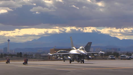 F15-And-F16-Fighter-Jets-Line-Up-And-Taxi-For-Takeoff-In-A-Military-Exercise-7