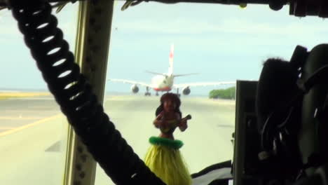 Pov-From-The-Cockpit-Of-A-Large-Military-Aircraft-Taxiing-With-A-Hula-Girl-Doll-Bobbling-Around