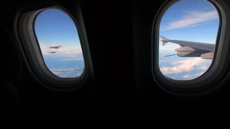 Pov-Out-Of-The-Window-Of-A-Plane-With-Fighter-Jets-Outside