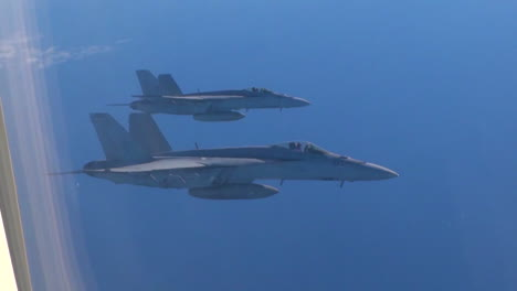 Pov-Out-Of-The-Window-Of-A-Plane-With-Fighter-Jets-Outside-1