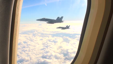 Pov-Out-Of-The-Window-Of-A-Plane-With-Fighter-Jets-Outside-2