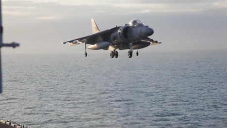 Marine-Harrier-Aircraft-In-Action-On-The-Deck-Of-An-Aircraft-Carrier