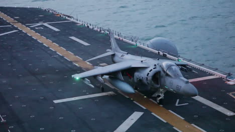 Marine-Harrier-Aircraft-In-Action-On-The-Deck-Of-An-Aircraft-Carrier-2