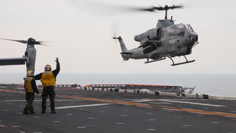 An-Ah1W-Super-Cobra-Helicopter-Lands-And-Takes-Off-From-The-Deck-Of-An-Aircraft-Carrier