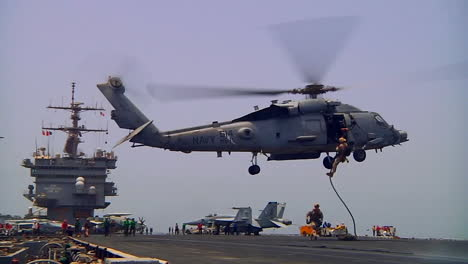 Helicopters-Drop-Troops-Who-Rappel-Onto-The-Deck-Of-An-Aircraft-Carrier