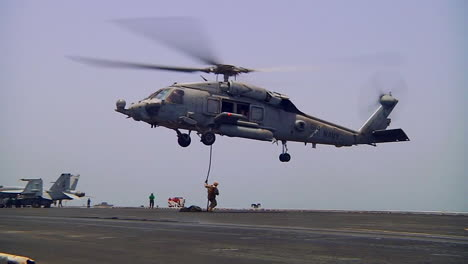 Helicopters-Drop-Troops-Who-Rappel-Onto-The-Deck-Of-An-Aircraft-Carrier-1