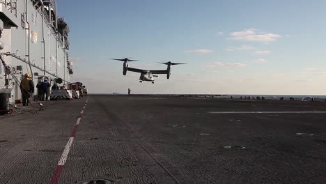 A-V22-Osprey-Helicopter-Lands-On-The-Deck-Of-An-Aircraft-Carrier