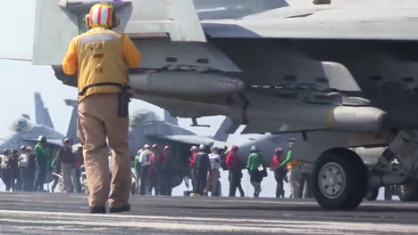 Various-Jet-Aircraft-Taxi-And-Maneuver-On-The-Deck-Of-An-Aircraft-Carrier
