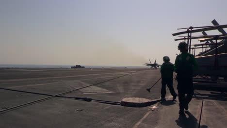 Various-Jet-Aircraft-Land-On-The-Deck-Of-An-Aircraft-Carrier