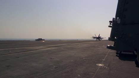 Various-Jet-Aircraft-Land-On-The-Deck-Of-An-Aircraft-Carrier-1