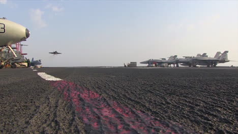 Various-Jet-Aircraft-Land-On-The-Deck-Of-An-Aircraft-Carrier-3