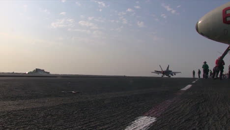 Various-Jet-Aircraft-Land-On-The-Deck-Of-An-Aircraft-Carrier-4
