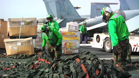 Goods-Are-Stacked-On-The-Deck-Of-An-Aircraft-Carrier-During-A-Replenishment-At-Sea-Exercise
