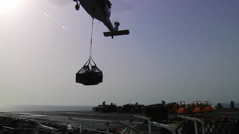 Helicopters-Move-Goods-Between-Aircraft-Carriers-During-A-Replenishment-Exercise-At-Sea