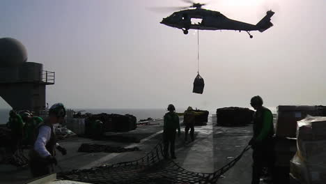 Helicopters-Move-Goods-Between-Aircraft-Carriers-During-A-Replenishment-Exercise-At-Sea-2