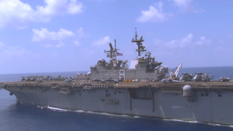 Aerial-Over-An-Aircraft-Carrier-As-Sea