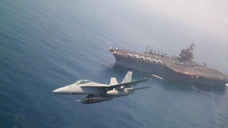 Aerials-Of-Jet-Fighter-Planes-Passing-An-Aircraft-Carrier-At-High-Speed