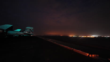 Night-To-Day-Time-Lapse-Of-Aircraft-Carrier-Through-The-Suez-Canal
