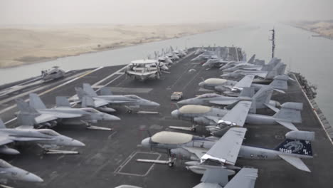 Day-Time-Lapse-Of-An-Aircraft-Carrier-Through-The-Suez-Canal