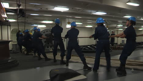 Sailors-Aboard-A-Navy-Ship-Haul-Ropes-On-The-Deck-Of-A-Warship-1