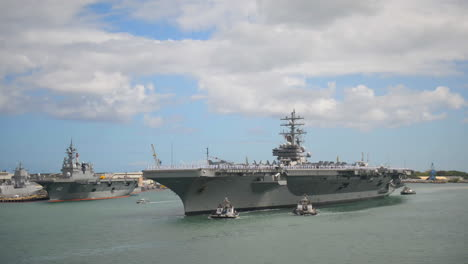 An-Aircraft-Carrier-With-All-Hands-On-Board-Pulls-Into-Pearl-Harbor-Hawaii