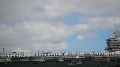 An-Aircraft-Carrier-With-All-Hands-On-Board-Pulls-Into-Pearl-Harbor-Hawaii-1