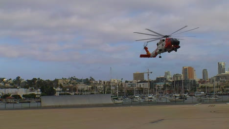 Coast-Guard-Helicopter-Lands-At-Landing-Site-And-Injured-People-Are-Taken-By-Paramedics-To-Hospital