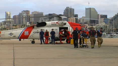 Coast-Guard-Helicopter-Lands-At-Landing-Site-And-Injured-People-Are-Taken-By-Paramedics-To-Hospital-1