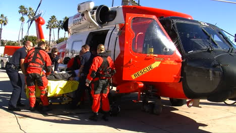 Coast-Guard-Helicopter-Lands-At-Landing-Site-And-Injured-People-Are-Taken-By-Paramedics-To-Hospital-3