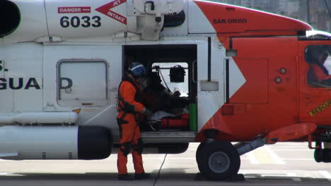 Coast-Guard-Helicopter-Lands-At-Landing-Site-And-Injured-People-Are-Taken-By-Paramedics-To-Hospital-5