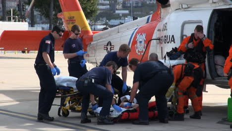 Coast-Guard-Helicopter-Lands-At-Landing-Site-And-Injured-People-Are-Taken-By-Paramedics-To-Hospital-6