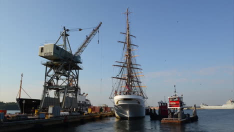 Time-Lapse-Of-Coast-Guard-Tall-Ship-Leaving-Port-And-Pov-Sailing-From-Bow