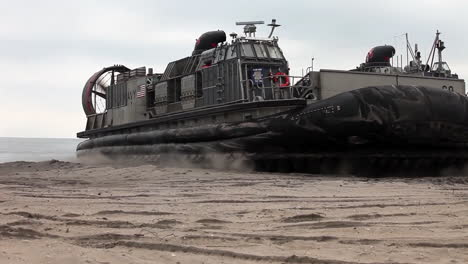 An-Amphibious-Assault-Vehicle-Inflates-And-Moves-Off-A-Beach