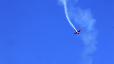 An-Old-Biplane-Performs-Aerial-Maneuvers-At-An-Air-Show-1