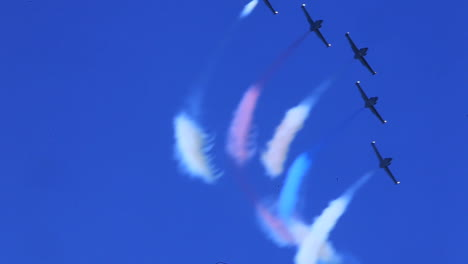 A-Formation-Of-Jet-Planes-Display-Red-White-And-Blue-Contrails