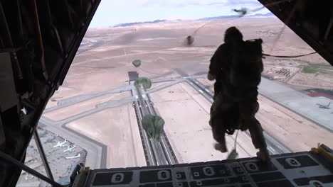 Paratroopers-Jump-From-An-Airplane-Over-An-Airfield