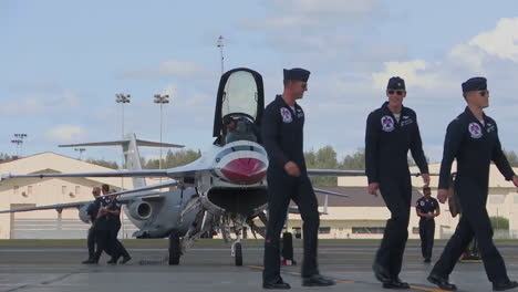 Members-Of-The-Thunderbirds-Fighter-Stunt-Team-Sign-Autographs-For-The-Crowd-At-An-Airshow