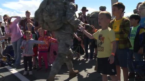 Children-Greet-Army-And-Military-Personnel-Returning-From-War