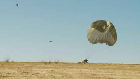 Ground-Angle-View-Of-Paratroopers-Parachuting-To-Earth-1