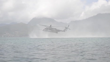 Navy-Seals-Train-On-Rubber-Zodiac-Watercraft-While-A-Helicopter-Performs-A-Helicasting-Maneuver