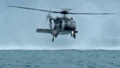 Paratroopers-Jump-From-A-Low-Flying-Helicopter-Into-An-Ocean-Bay