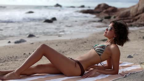 Woman-Relaxing-on-a-Beach-0-13