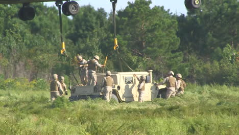 The-Sikorsky-Ch53-Helicopter-Lifts-And-Moves-A-Humvee-From-A-Field