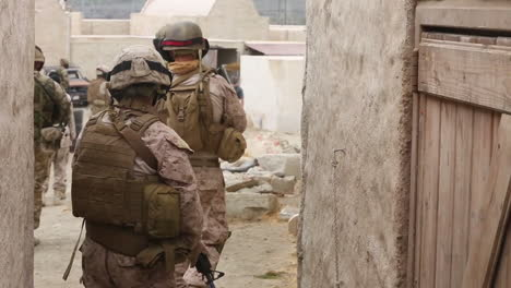 Us-Marines-British-Forces-And-Navy-Seals-Conduct-A-Patrol-In-A-Simulated-African-Village-5