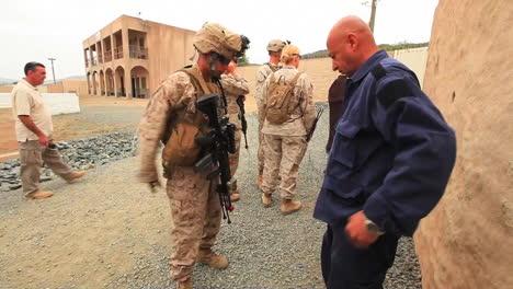 Us-Marines-And-Navy-Seals-Walk-On-Patrol-Through-A-Simulated-Arab-Village-4